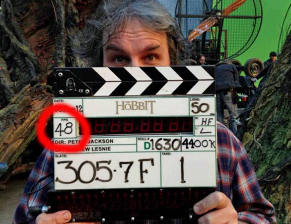 Director Peter Jackson with clapperboard on the movie set