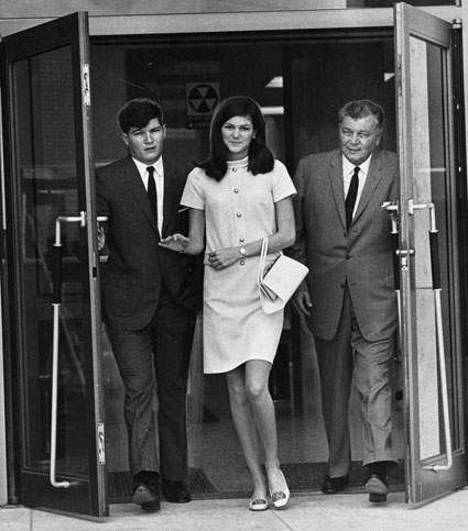 Barbara Jane Mackle leaves the courtroom with her father Robert and her brother
