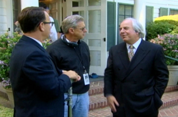 Actor Tom Hanks, F.B.I. Technical Advisor William Rehder and Frank Abagnale on the movie set